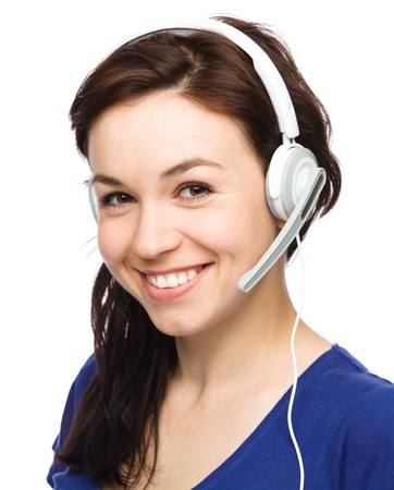Closeup portrait of lovely young woman talking to customers as a consultant using headset, isolated over white Imagens