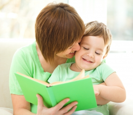 Mother is reading book for her son, indoor shoot Stock Photo - 16367962