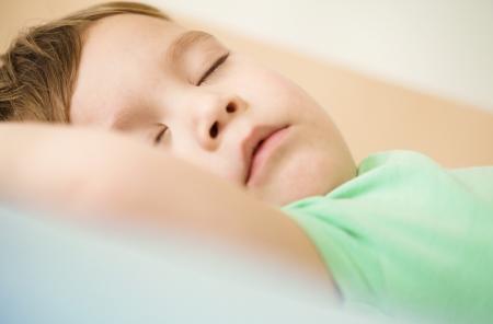 snoring: Portrait of a cute little boy sleeping in bed