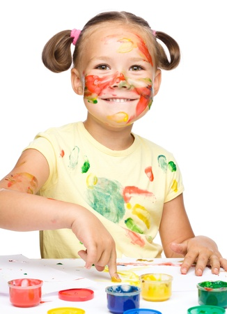 Portrait of a cute cheerful girl playing with paints, isolated over white Stock Photo - 16521808