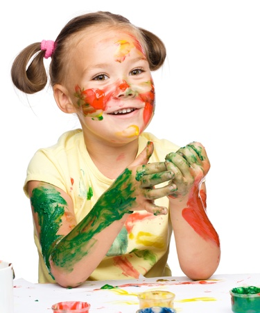 Portrait of a cute cheerful girl playing with paints, isolated over white Stock Photo - 16521847
