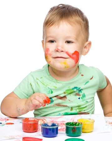 Portrait of a cute little boy playing with paints, isolated over white Stock Photo - 16521812