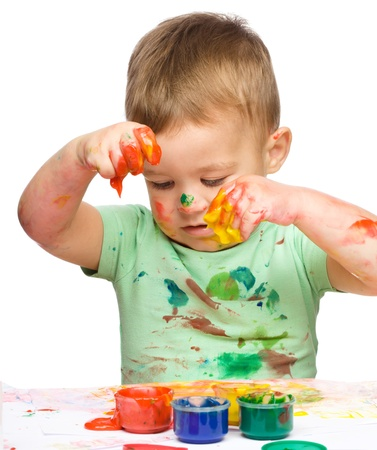 Portrait of a cute little boy playing with paints, isolated over white Stock Photo - 16521775