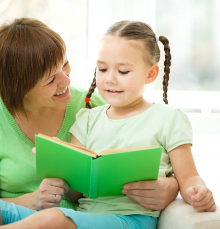 Mother is reading book for her daughter, indoor shoot Stock Photo - 16521867