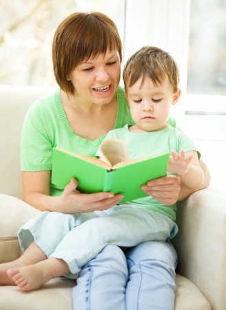Mother is reading book for her son, indoor shoot Stock Photo - 16521868