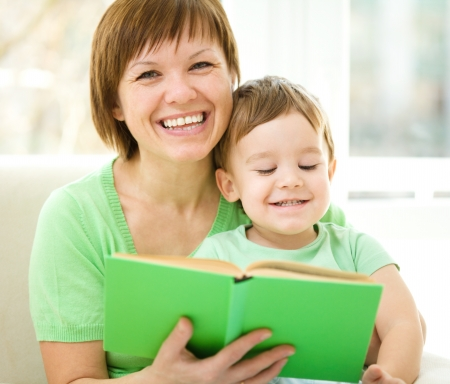 Mother is reading book for her son, indoor shoot Stock Photo - 16521804