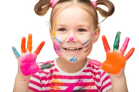 Portrait of a cute cheerful girl showing her hands painted in bright colors, isolated over white Stock Photo - 16695879