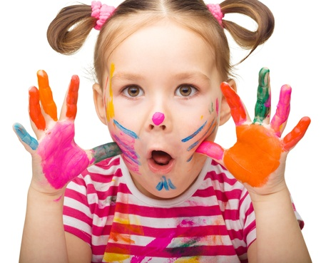 Portrait of a cute girl showing her hands painted in bright colors, isolated over white Stock Photo - 16695878