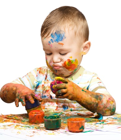 Portrait of a cute little boy playing with paints, isolated over white Stock Photo - 16695869