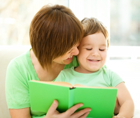 Mother is reading book for her son, indoor shoot Stock Photo - 16792285