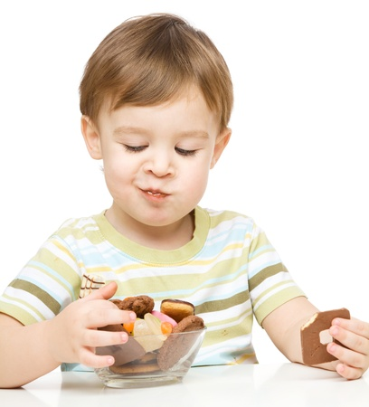 Portrait of a boy with cookies, isolated over white Stock Photo - 17107386