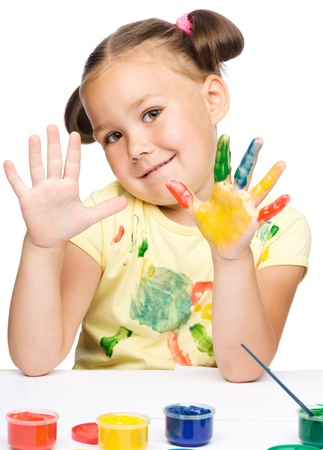 Portrait of a cute cheerful girl showing her hands painted in bright colors, isolated over white Stock Photo - 17055236