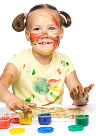 Portrait of a cute cheerful girl playing with paints, isolated over white Stock Photo - 17055234