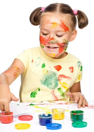 Portrait of a cute cheerful girl playing with paints, isolated over white Stock Photo - 17055206