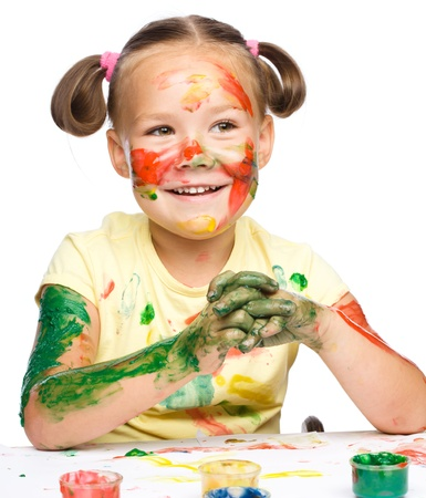 Portrait of a cute cheerful girl playing with paints, isolated over white Stock Photo - 17160581