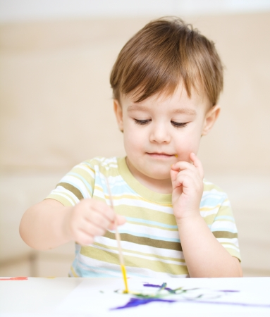Portrait of a cute little boy playing with paints Stock Photo - 17160606
