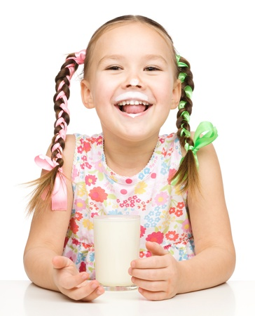 Cute little girl showing milk moustache, isolated over white