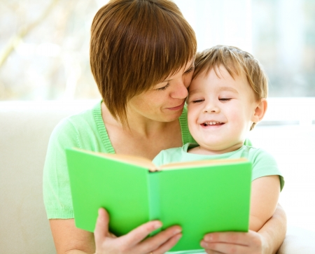 Mother is reading book for her son, indoor shoot Stock Photo - 17412142