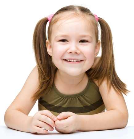 Portrait of a cute cheerful little girl, isolated over white photo