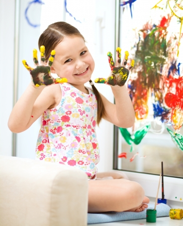 Portrait of a cute cheerful girl showing her painted hands Stock Photo - 17576734