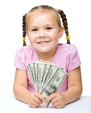 Cute little girl with dollars, isolated over white photo
