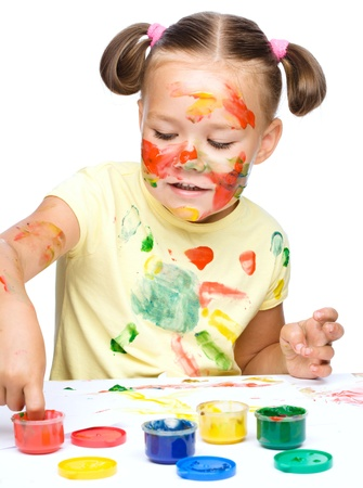 fingerpaint: Portrait of a cute cheerful girl playing with paints, isolated over white