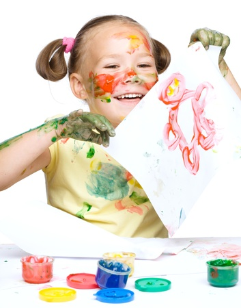 Portrait of a cute cheerful girl showing her drawing, isolated over white Stock Photo - 17886657