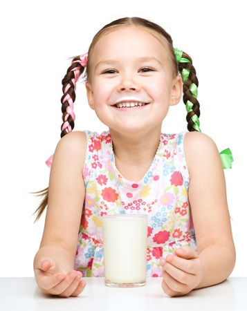 moustache: Cute little girl showing milk moustache, isolated over white