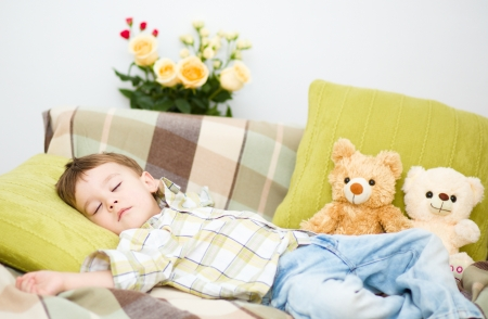 Cute little boy is sleeping next to his teddy bears Stock Photo - 17886747