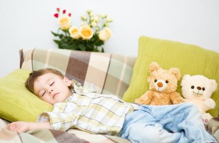 Cute little boy is sleeping next to his teddy bears Stock Photo - 17886747