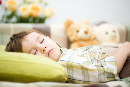 Cute little boy is sleeping next to his teddy bears Stock Photo - 17886760