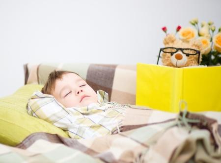Cute little boy is sleeping in front of his teddy bear Stock Photo - 17886743