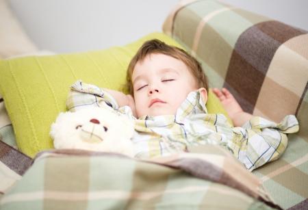 Cute little boy is sleeping with his teddy bear Stock Photo - 17886748