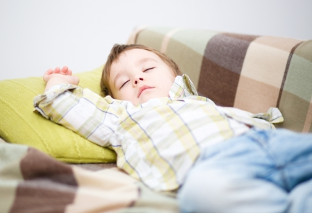 drowse: Portrait of a cute little boy sleeping on white pillow