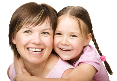 Portrait of a happy daughter piggyback ride her mother, isolated over white photo