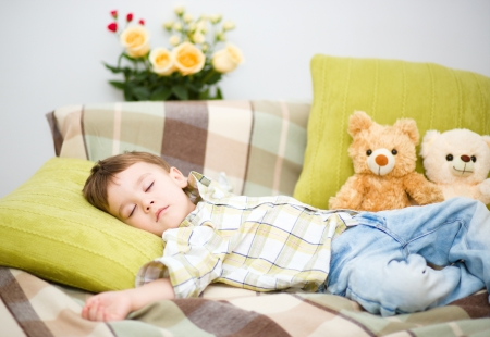Cute little boy is sleeping next to his teddy bears Stock Photo - 18441394