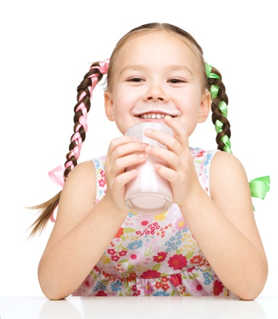 Cute little girl showing milk moustache, isolated over white photo