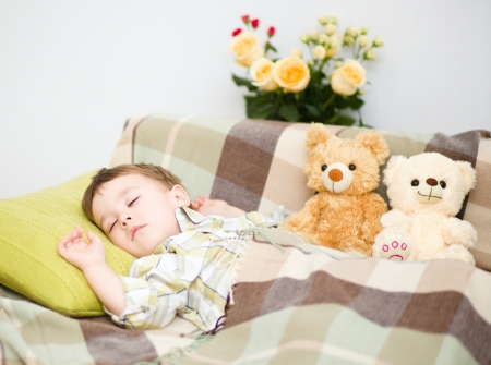 Cute little boy is sleeping next to his teddy bears Stock Photo - 18503033