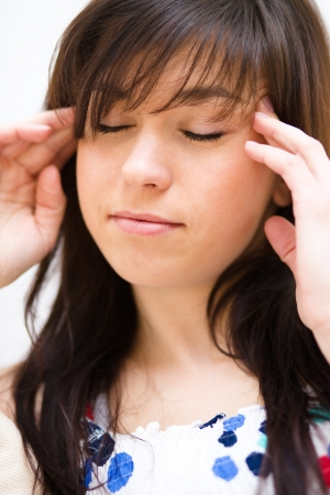 Young woman is suffering headache photo
