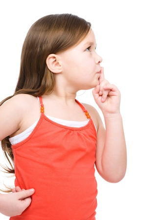 noiseless: Little girl is showing hush gesture, isolated over white Stock Photo