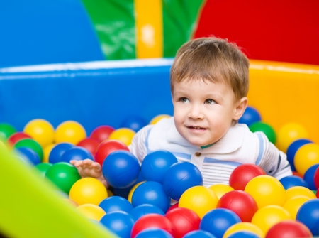 kids party: Little boy is playing on playground Stock Photo