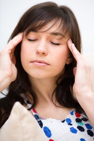 sore eye: Young woman is suffering headache