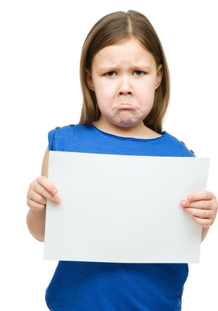 child sad: Little girl is holding blank banner and looks very unhappy about it, isolated over white Stock Photo