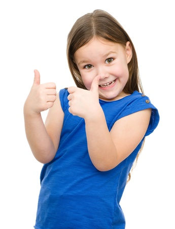 dressed up: Little girl dressed in blue is showing thumb up gesture using both hands, isolated over white