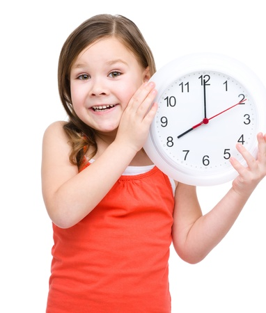 Little girl is holding big clock, isolated over white Stock Photo