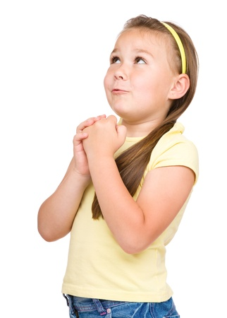 blessing: Cute little girl is praying, isolated over white