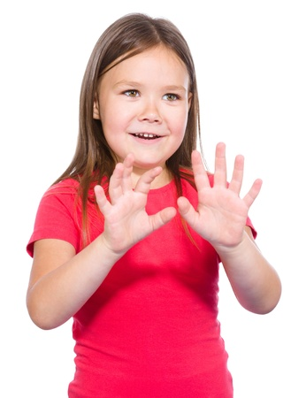 Portrait of a little girl making stop gesture using both hands, isolated over white photo