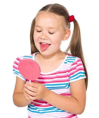 Little girl is going to lick her big lollipop, isolated over white photo