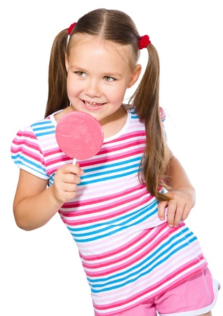 Happy little girl with big lollipop, isolated over white photo