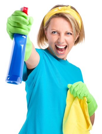 fiercely: Young woman as a cleaning maid fiercely spraying liquid from blue sprayer, isolated over white